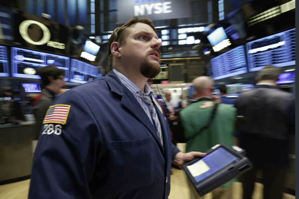 Trader Michael Milano works on the floor of the New York Stock Exchange Thursday. The U.S. stock market is opening sharply lower following a renewed drop in Chinese shares.