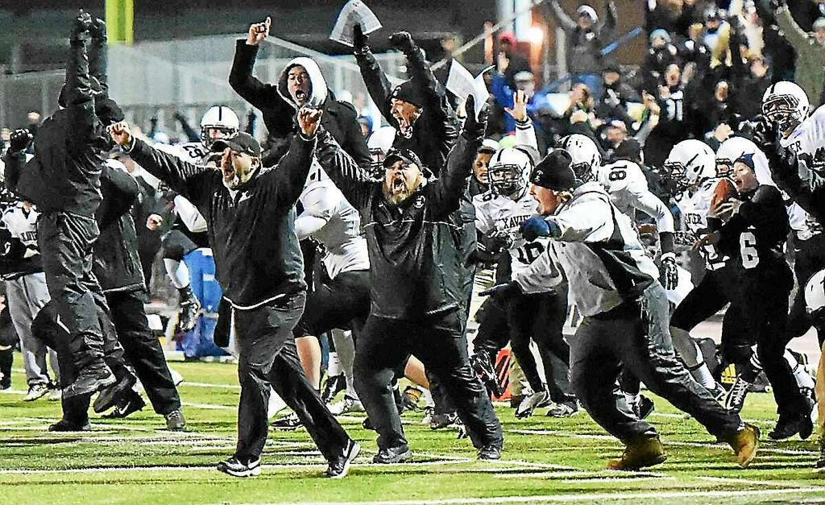 Peter Hvizdak - Register Xavierís sideline reacts to winning the Class LL-Small title over Shelton 28-27 in overtime last year