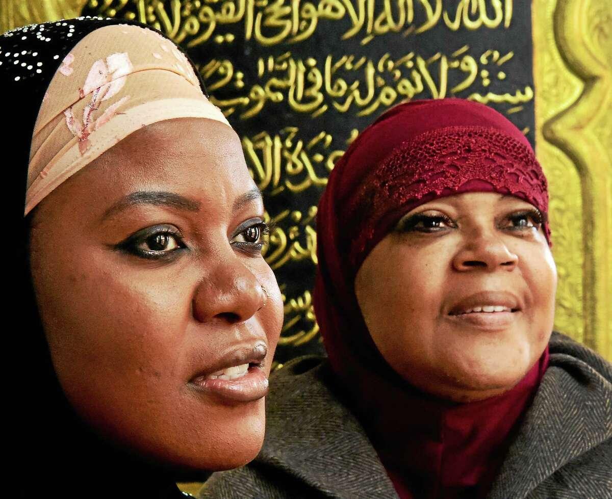 Mariam Nalumbanga of Hartford, left, and Khaliah Abdul-Karim of Hamden, at the Muhammed Islamic Center of Greater Hartford Tuesday.
