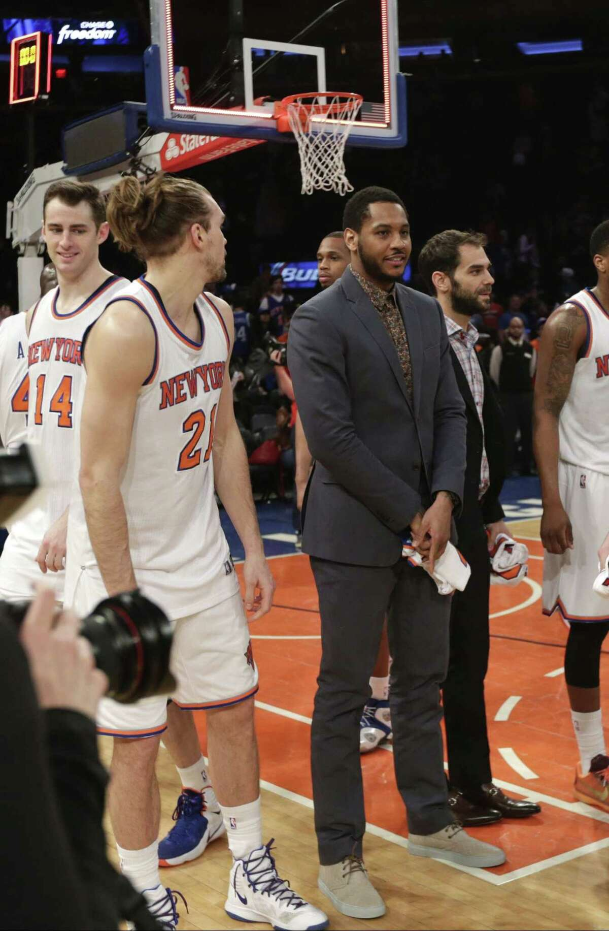 Knicks star Carmelo Anthony stands on the court with his teammates after a game against the Detroit Pistons on Wednesday in New York.