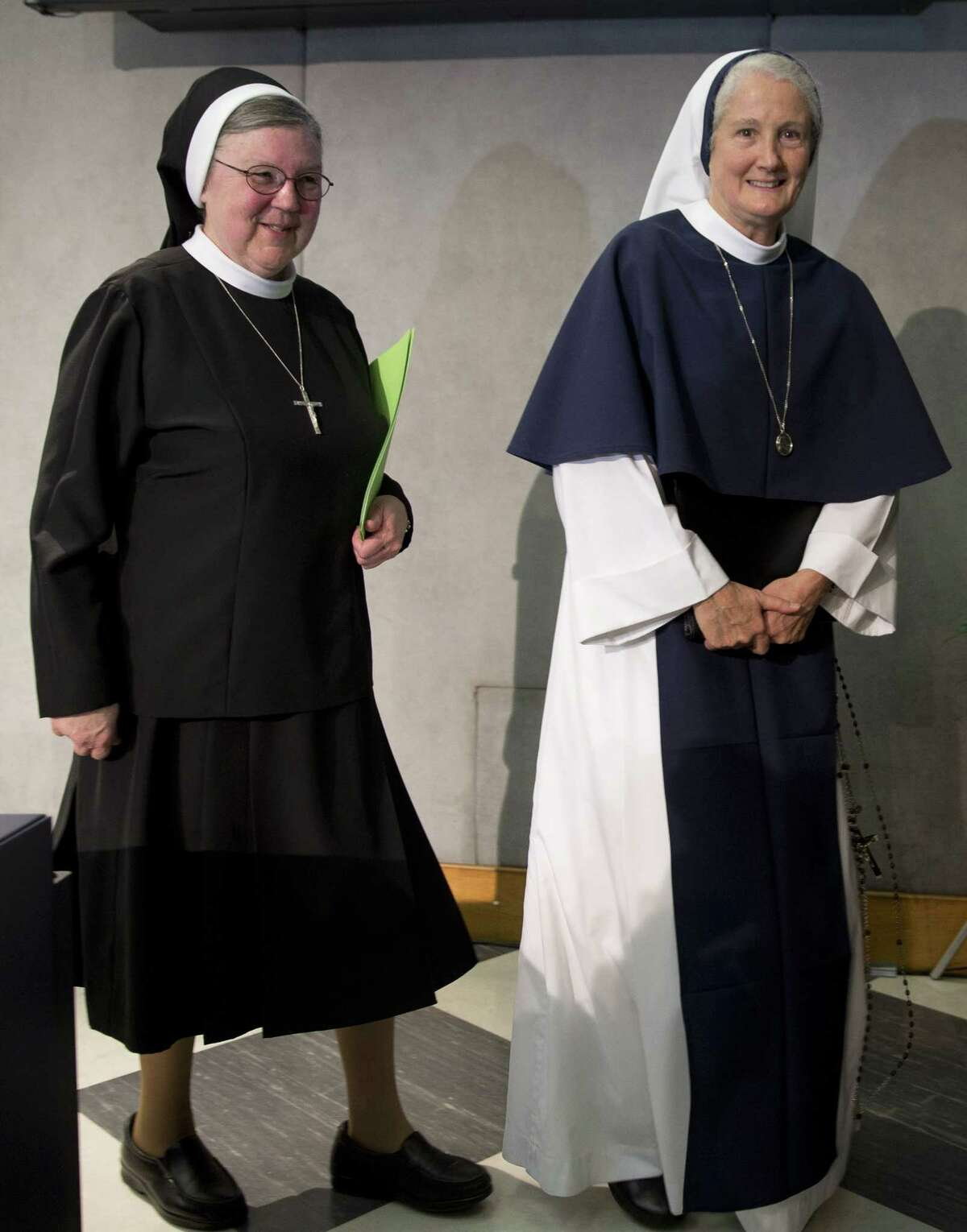 "Mother Mary Clare Millea, left, and Sister Agnes Mary Donovan leave at the end of a press conference at the Vatican on Dec. 16, 2014. The Vatican went out of its way to mend fences with American religious sisters, thanking them for their selfless work caring for the poor, gently suggesting ways to survive amid a decline in numbers and promising to value their ""feminine genius"" more."