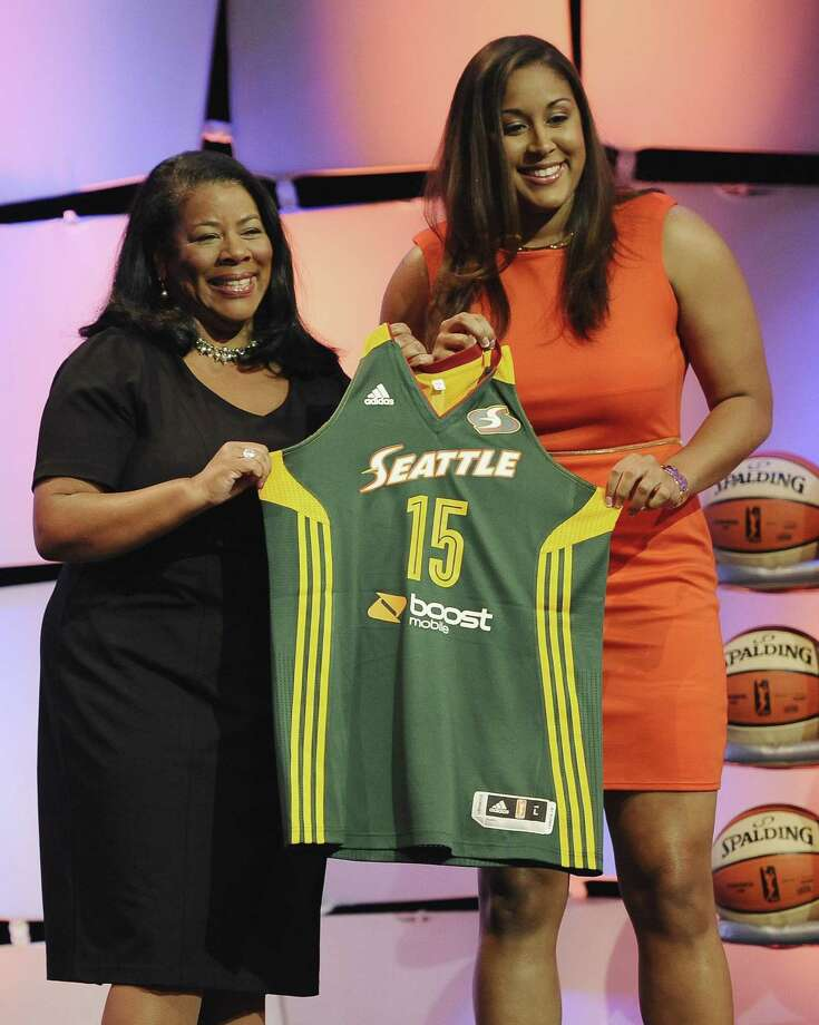 UConn's Kaleena Mosqueda-Lewis, right, holds up a Seattle Storm jersey with WNBA president Laurel J. Richie after the Storm selected Mosqueda-Lewis with the No. 3 pick in the WNBA draft on Thursday. Photo: Jessica Hill — The Associated Press  / FR125654 AP