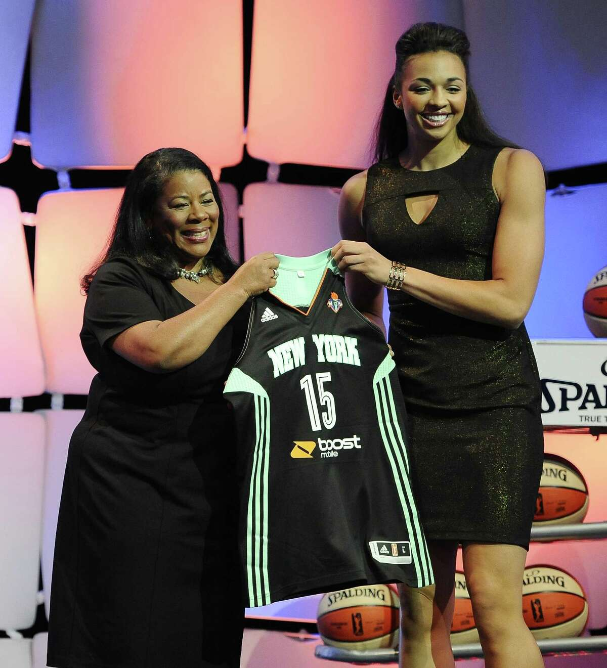 UConn's Kiah Stokes, right, holds up a New York Liberty jersey after the Liberty selected Stokes with the No. 11 pick.