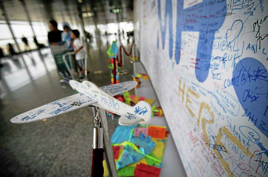 A foam plane with messages and cards with personalized messages dedicated to people involved with the missing Malaysia Airlines jetliner MH370, are placed in the viewing gallery at Kuala Lumpur International Airport, Saturday, March 15, 2014 in Sepang, Malaysia. A Malaysian passenger jet missing for more than a week had its communications deliberately disabled and its last signal came about seven and a half hours after takeoff, meaning it could have ended up as far as Kazakhstan or deep in the southern Indian Ocean, Malaysia's Prime Minister Najib Razak said Saturday.(AP Photo/Wong Maye-E) Photo: AP / AP