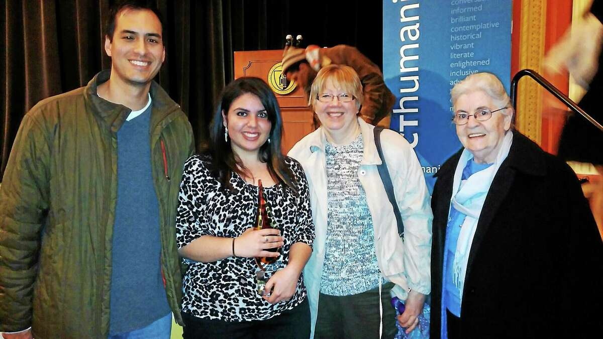 From left, Mercy English Department Chairman Terence McCaffrey stands with senior Michaella Toledo along with Jo-Ellen Narstis and Sr. Anne Walsh after winning the Connecticut State Poetry Out Loud competition. Toledo goes on to the national competition on April 28 in Washington, D.C.