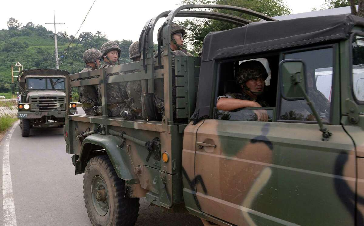 South Korean army soldiers ride on a truck in Yeoncheon, south of the demilitarized zone that divides the two Koreas, South Korea, Friday, Aug. 21, 2015. North Korean leader Kim Jong Un on Friday declared his frontline troops in a
