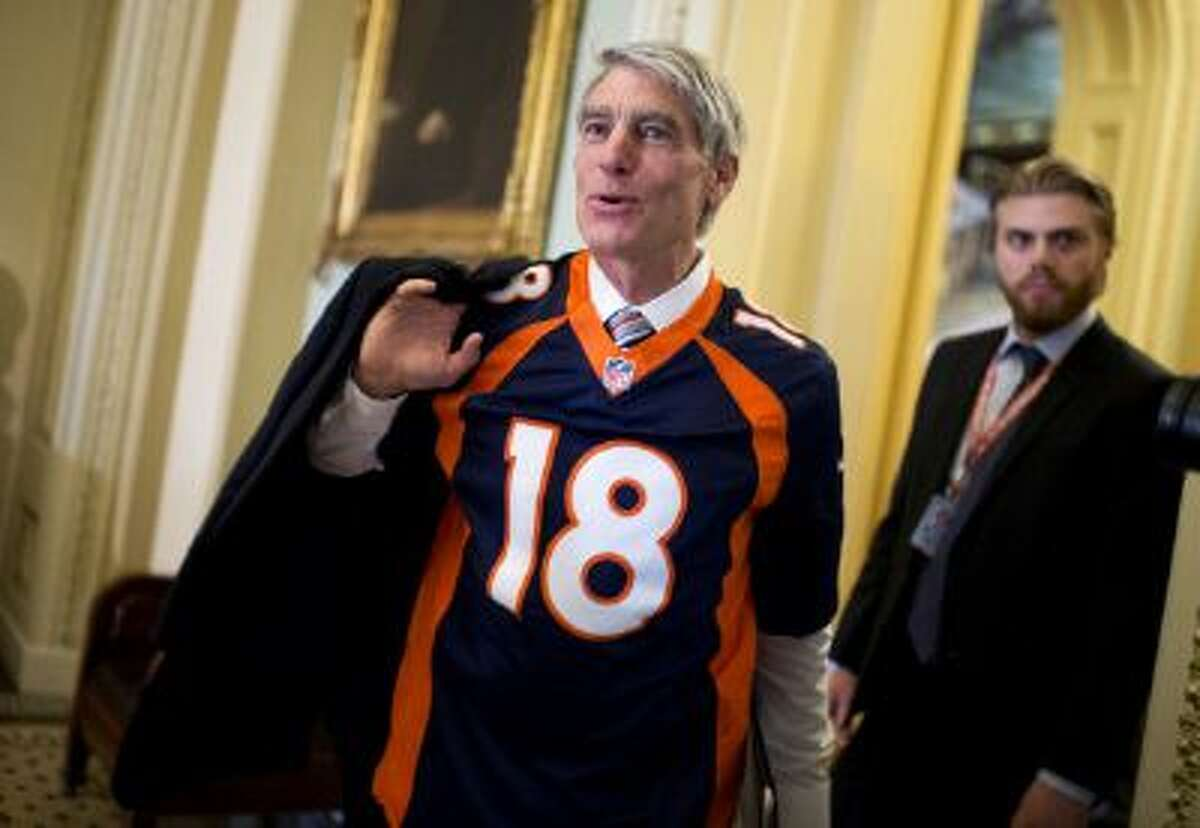 Sen. Mark Udall, D-Colo., sports a Denver Broncos jersey on Capitol Hill ahead of the Super Bowl.