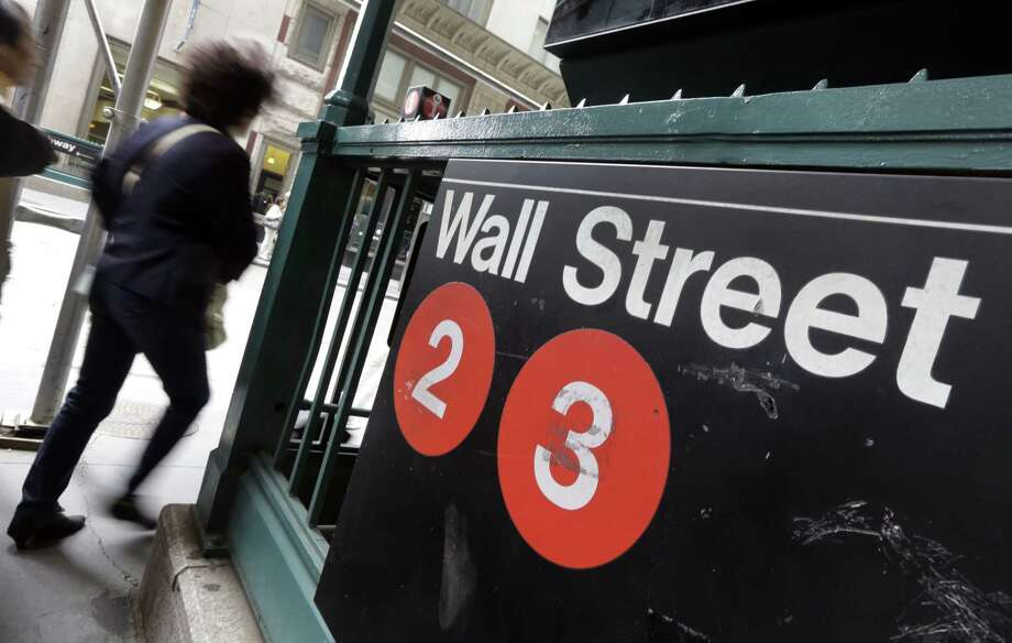 People pass a Wall Street subway stop in New York's Financial District. Photo: Richard Drew — The Associated Press  / AP