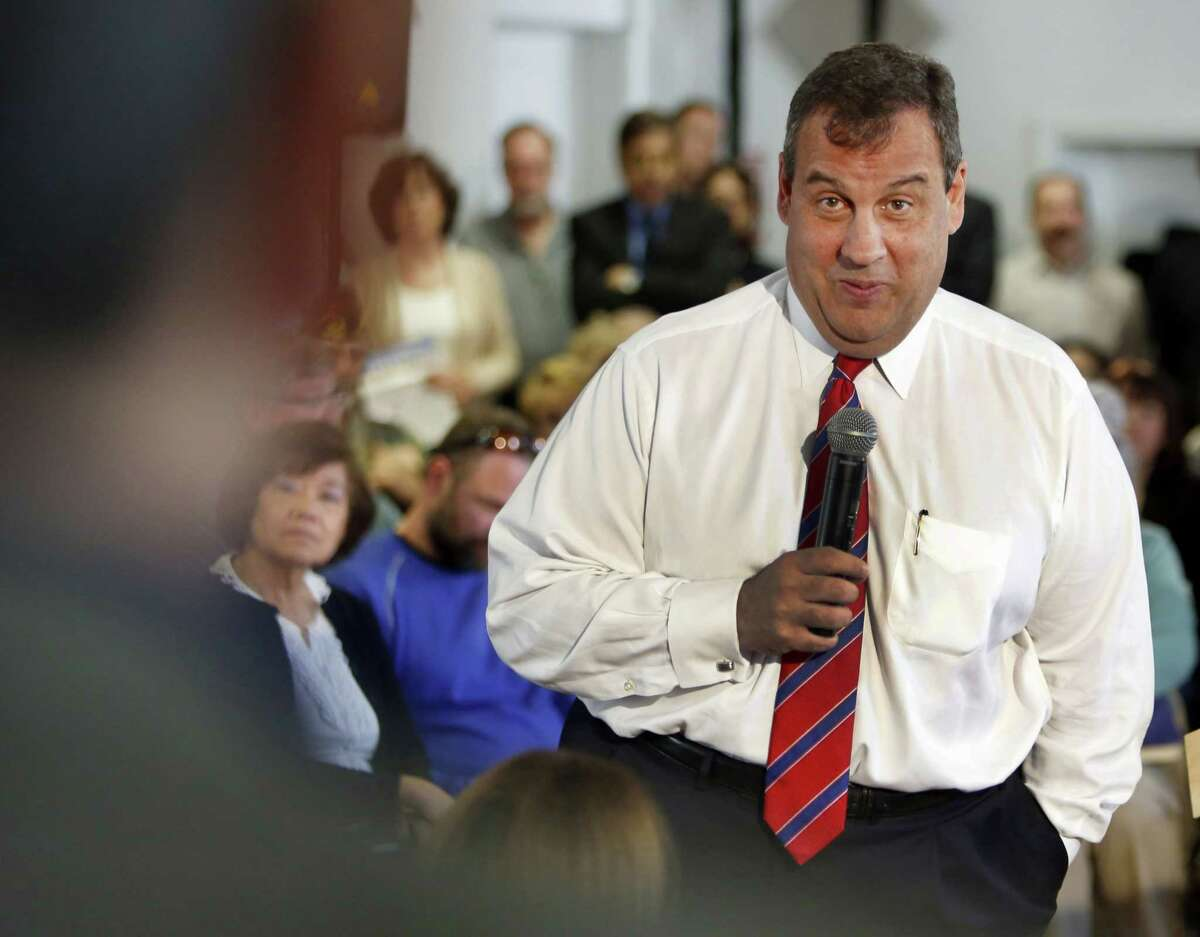 New Jersey Gov. Chris Christie, R-N.J. takes a questions during a town hall meeting with area residents in Londonderry, N.H., Wednesday, April 15, 2015. Christie introduced himself to New Hampshire voters Wednesday in a format he knows well -- a town hall meeting.