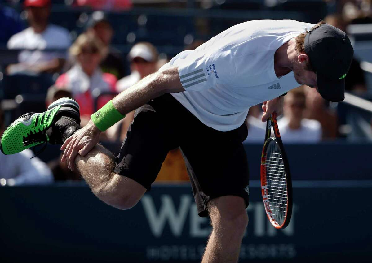 Andy Murray stretches his leg between serves against Robin Haase during the opening round of the U.S. Open on Monday in New York.