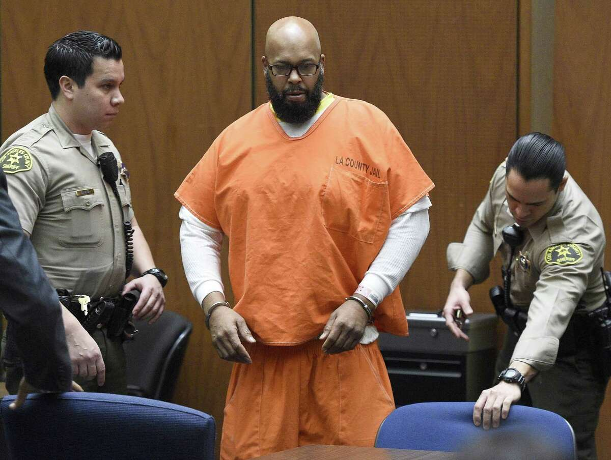 """FILE - In this March 9, 2015 file photo, Marion """"Suge"""" Knight arrives in court for a hearing about evidence in his murder case, in Los Angeles. Knight is scheduled to return to court on Thursday, April 16, 2015, for the conclusion of a preliminary hearing in which a judge determines whether there is enough evidence for the former rap music mogul to stand trial on murder, attempted murder and hit-and-run charges filed after he struck two men with his pickup truck in late January."""