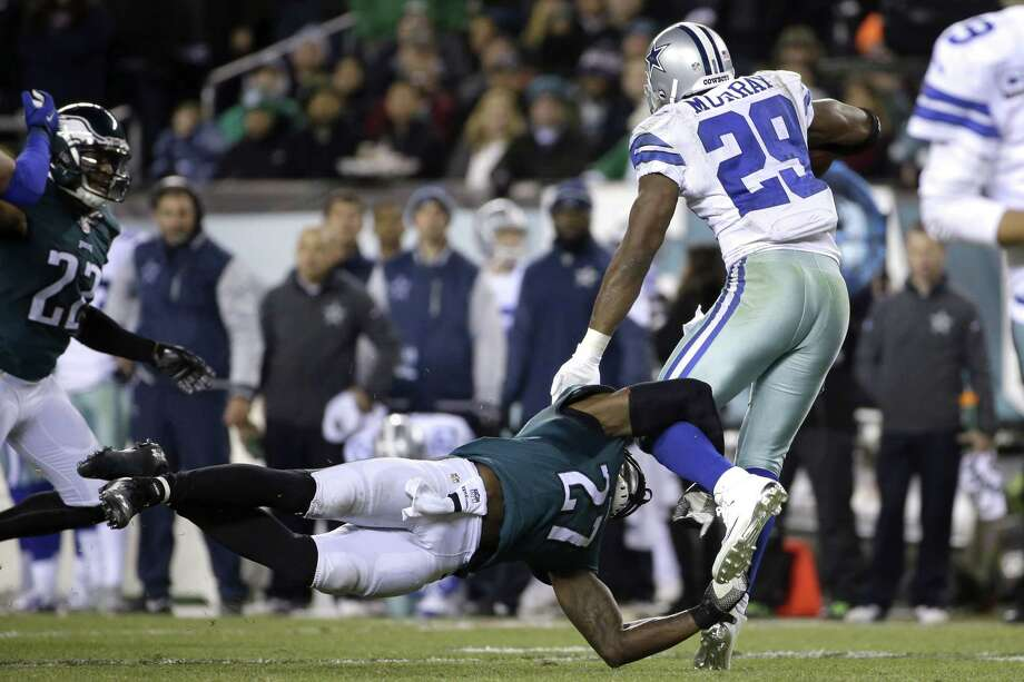 Dallas Cowboys running back DeMarco Murray is tackled by the Eagles' Malcolm Jenkins during the second half of Sunday night's game in Philadelphia. Photo: Michael Perez — The Associated Press  / FR168006 AP