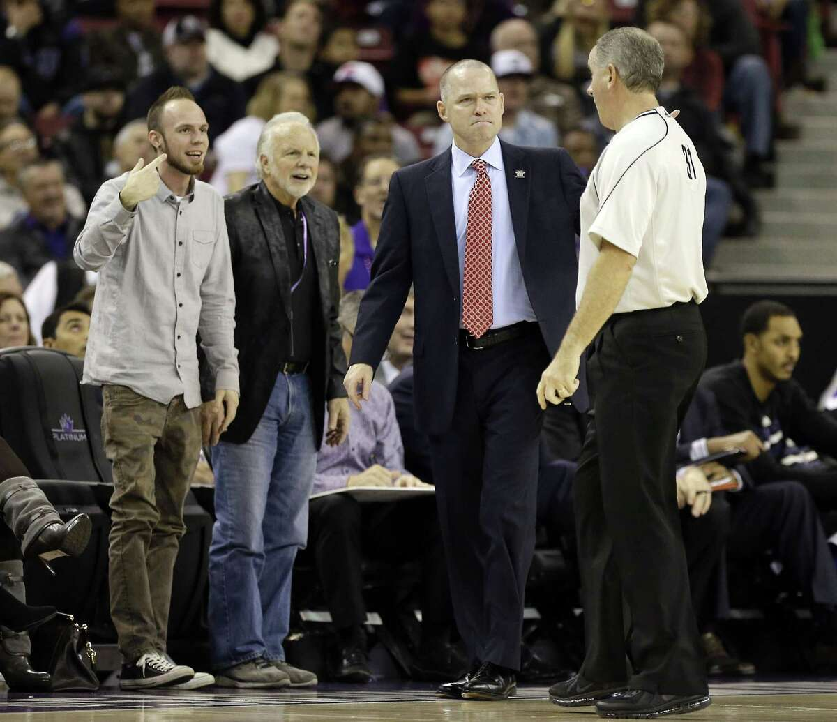 Official Scott Wall, right, explains a foul he called against Sacramento to Kings head coach Michael Malone, second from right, during the fourth quarter of a Dec. 2 game against the Toronto Raptors in Sacramento, Calif.