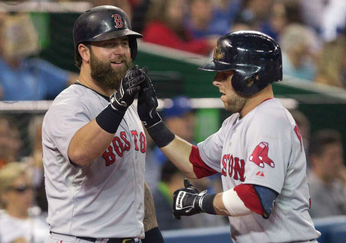 Dustin Pedroia, right, is congratulated by teammate Mike Napoli after Pedroia hit a two-run home run in the fifth inning Monday.