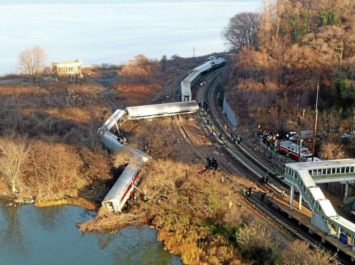 "Cars from a Metro-North passenger train are scattered after the train derailed in the Bronx, N.Y., Dec. 1. There were ""multiple injuries"" in the train derailment. (AP Photo/Edwin Valero)"