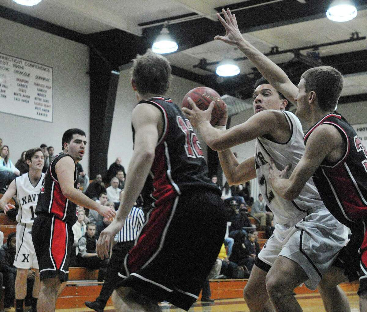 Xavier's Kaleb Lutton looks to make a pass during a game against Cheshire last season.