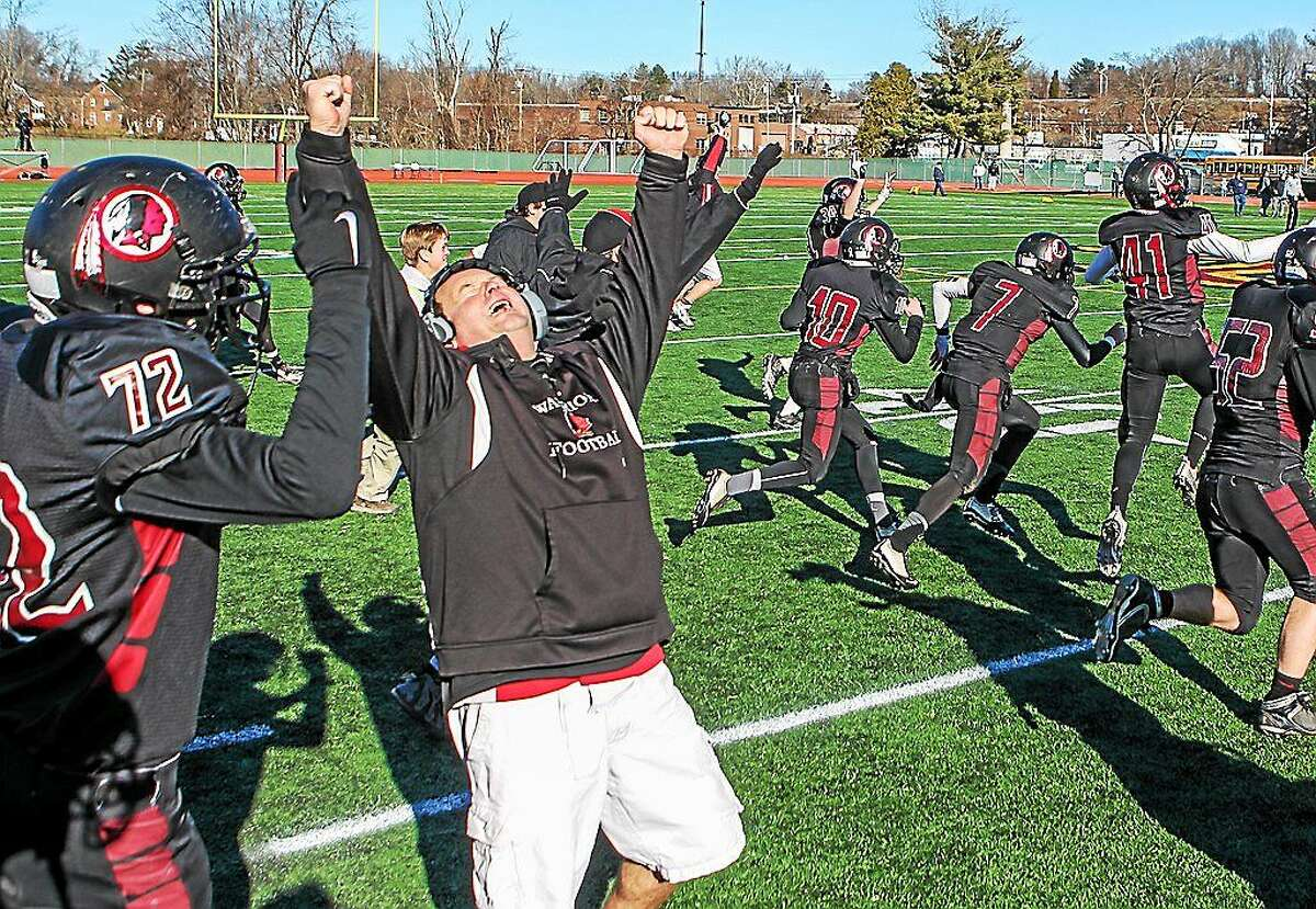 Valley Regional/Old Lyme head coach Tim King is jubilant following the Warriors' dramatic 21-20 victory over Ansonia in the Class S-Large championship game Saturday at New Britain.