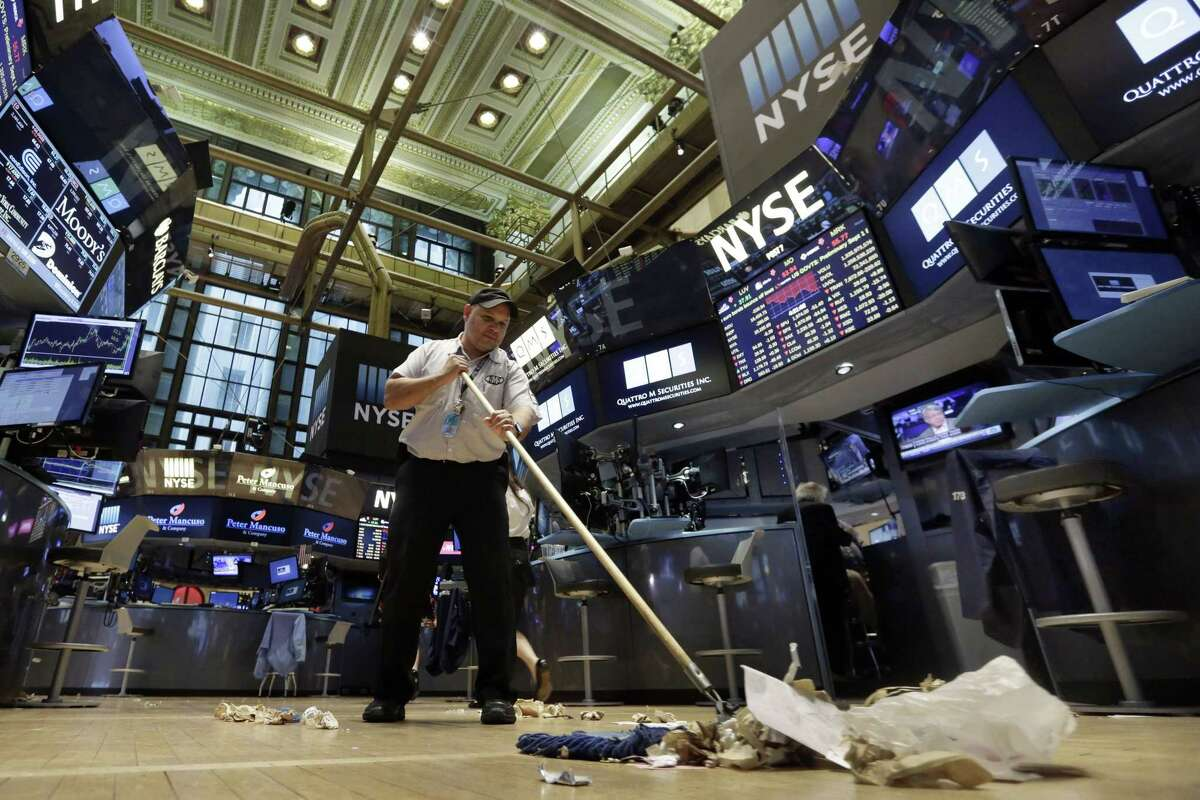Raul Rodriguez sweeps the floor of the New York Stock Exchange after the close of trading, Friday, Aug. 21, 2015. The Dow Jones industrial average fell to 16,459.75, and ended down 3.1 percent on Friday. The Standard & Poor's 500 index dropped 64.84 points, or 3.2 percent, to 1,970.89.