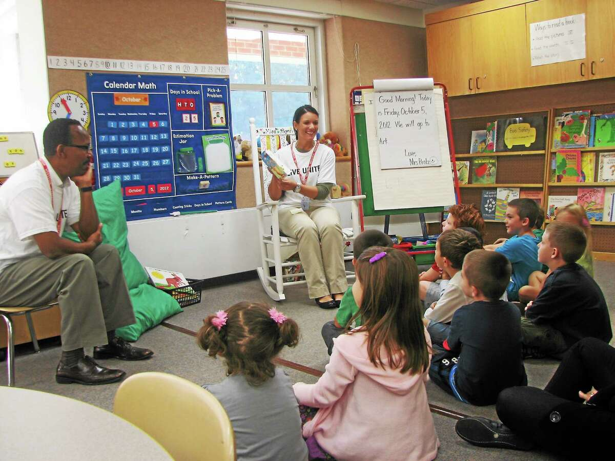 Submitted photo Employees from Citizenís Bank in Middletown volunteer for the Middlesex United Way's Day of Caring reading to students in Durham.
