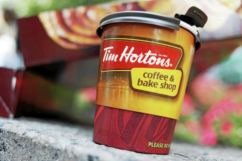 Tim Hortons has moved into 12 former Dunkin Donut locations earlier in the month, bringing new blood to the doughnut war in America's most competitive market. (AP Photo/Seth Wenig, File) Photo: AP / A2009