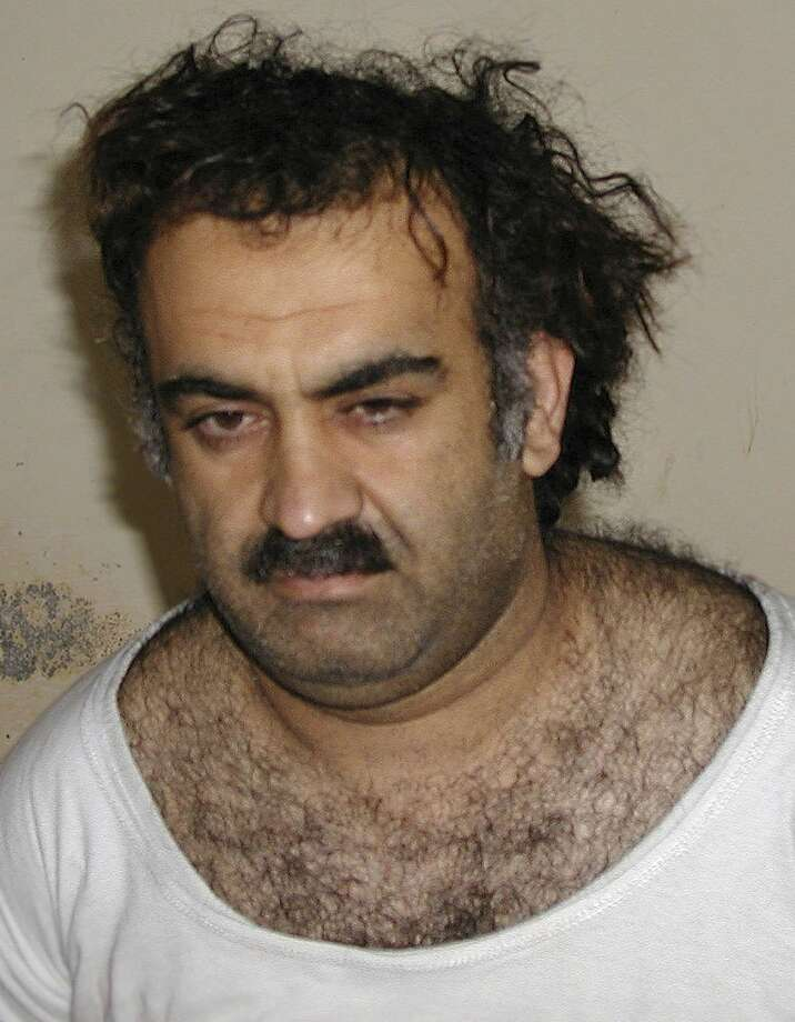 In this March 1, 2003 photo, Khalid Sheikh Mohammed, shortly after his capture during a raid in Pakistan. When CIA interrogators were torturing 9/11 mastermind Khalid Sheikh Mohammed at a secret prison in Poland in March 2003, a top CIA analyst asked the interrogators to show Mohammed a photograph of an alleged terrorist named Majid Khan. The interrogators slapped Mohammed, denied him sleep, rehydrated him through his rectum, threatened to kill his children and waterboarded him 183 times. And he offered up details on Khan. Photo: AP Photo, File  / AP