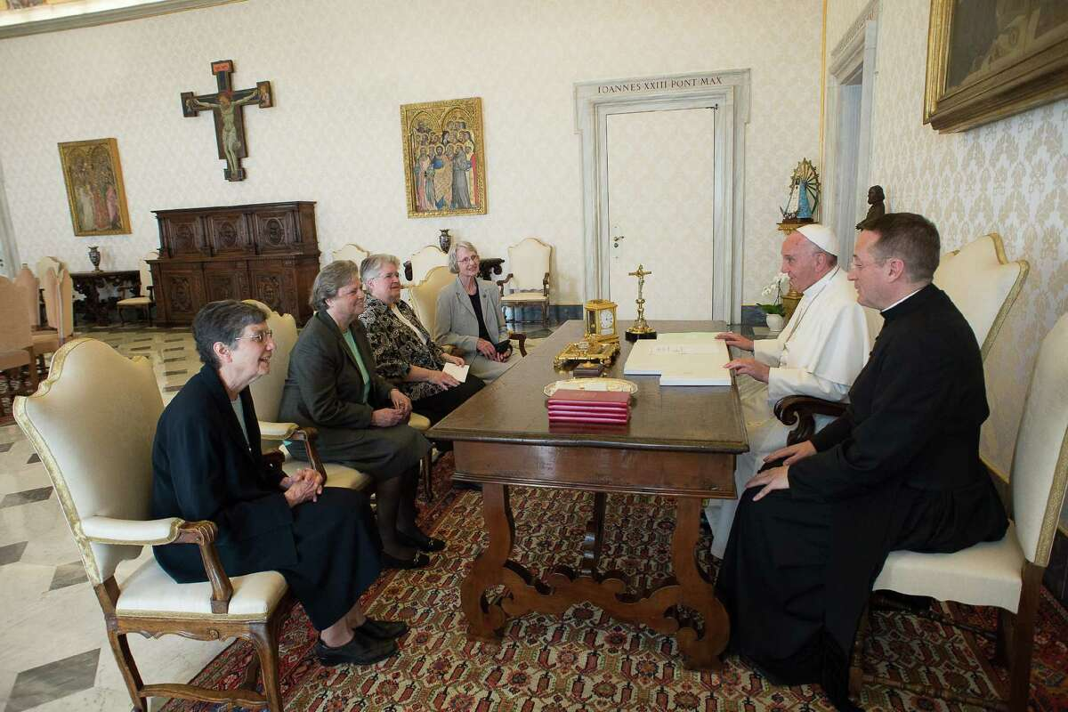 Pope Francis, second right, talks with a delegation of The Leadership Conference of Women Religious during an audience in the pontiff's studio at the Vatican, Thursday, April 16, 2015. The Vatican has announced the unexpected conclusion of a controversial overhaul of the main umbrella group of US nuns in a major shift in tone and treatment of American nuns under the social justice-minded Pope Francis. (LíOsservatore Romano/Pool Photo via AP)