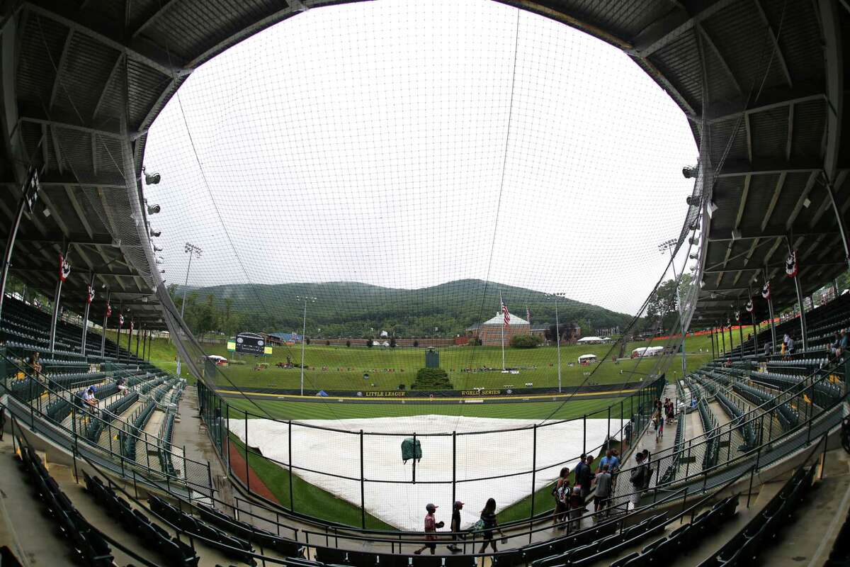 Rain falls on the covered field at Lamade Stadium Thursday in South Williamsport, Pa. The opening ceremony and the first day of four games of the Little League World Series has been postponed due to rain.