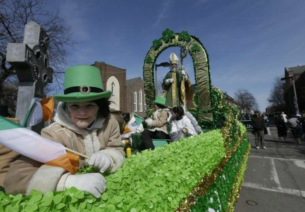 A girl holds an Irish flag while in costume on a float in the St. Patrick's Day Parade, in Boston, March 17, 2013. The parade may lift a 20-year ban on gay organizations this year. (Steven Senne, AP)