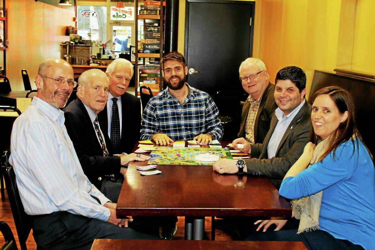 The Board Room at 514 Main St., held its grand opening Dec. 7, where Chamber staff and city dignitaries sat down to play the game of Life. From left are: Downtown Business District Treasurer Michael DiPiro, Larry McHugh, Middletown Small Business Development Center Counselor Paul Dodge, Board Room co-owner Tenzin Masselli, Chamber Central Business Bureau Chairman Tom Byrne, Middletown Mayor Dan Drew and Board Room co-owner Jennifer Alexander
