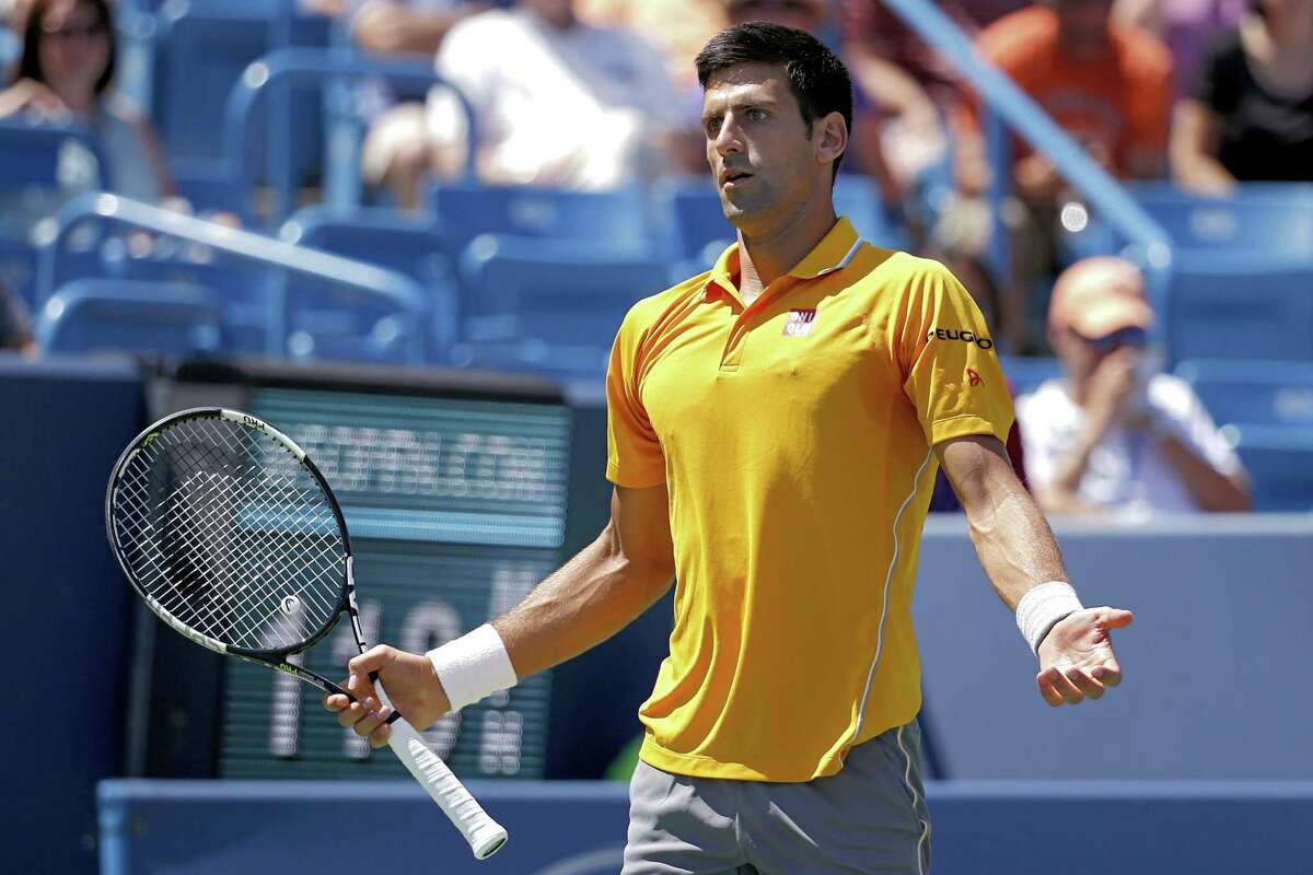 Novak Djokovic reacts during a match against David Goffin on Thursday at the Western & Southern Open in Mason, Ohio.