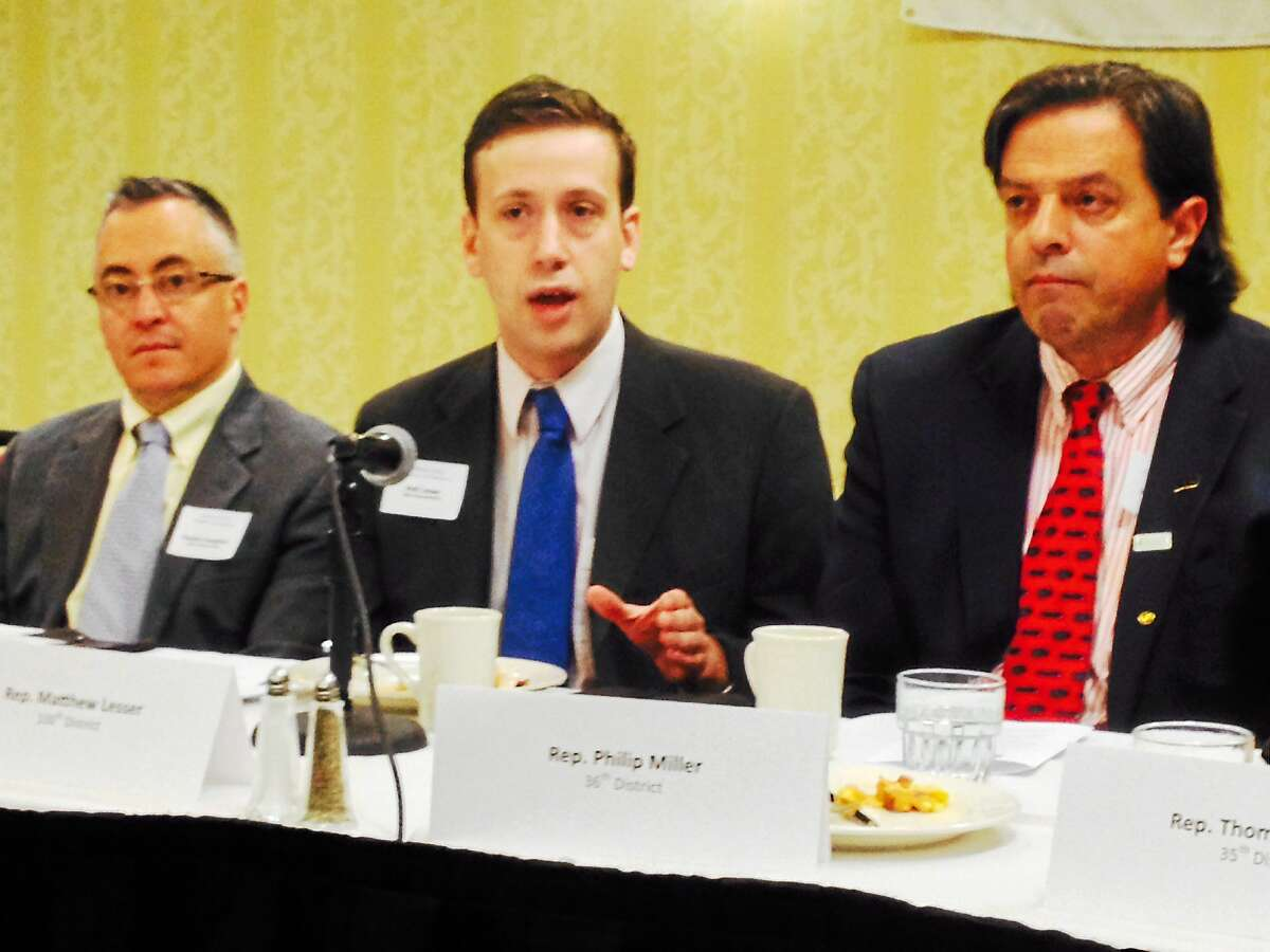 State Rep. Matthew Lesser (center) speaks on the state's minimum wage increase plans at the Middlesex Chamber of Commerce Legislative Committee breakfast Friday in Cromwell. At right is state Rep. Phil Miller.
