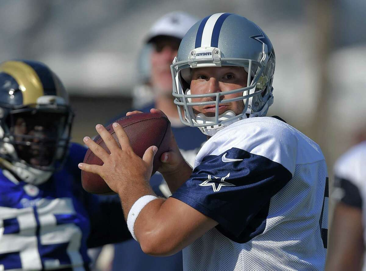 Dallas Cowboys quarterback Tony Romo looks to pass during a joint training camp with the St. Louis Rams on Tuesday in Oxnard, Calif.