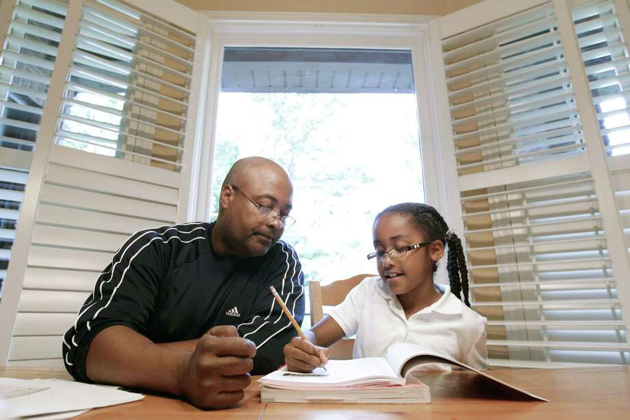 While some parents may feel the pressure to help their child with homework by actually writing essays and completing assignments for them, this seventh-grade teacher says doing so really doesn't help students in the long run. Photo: File Photo  / AP