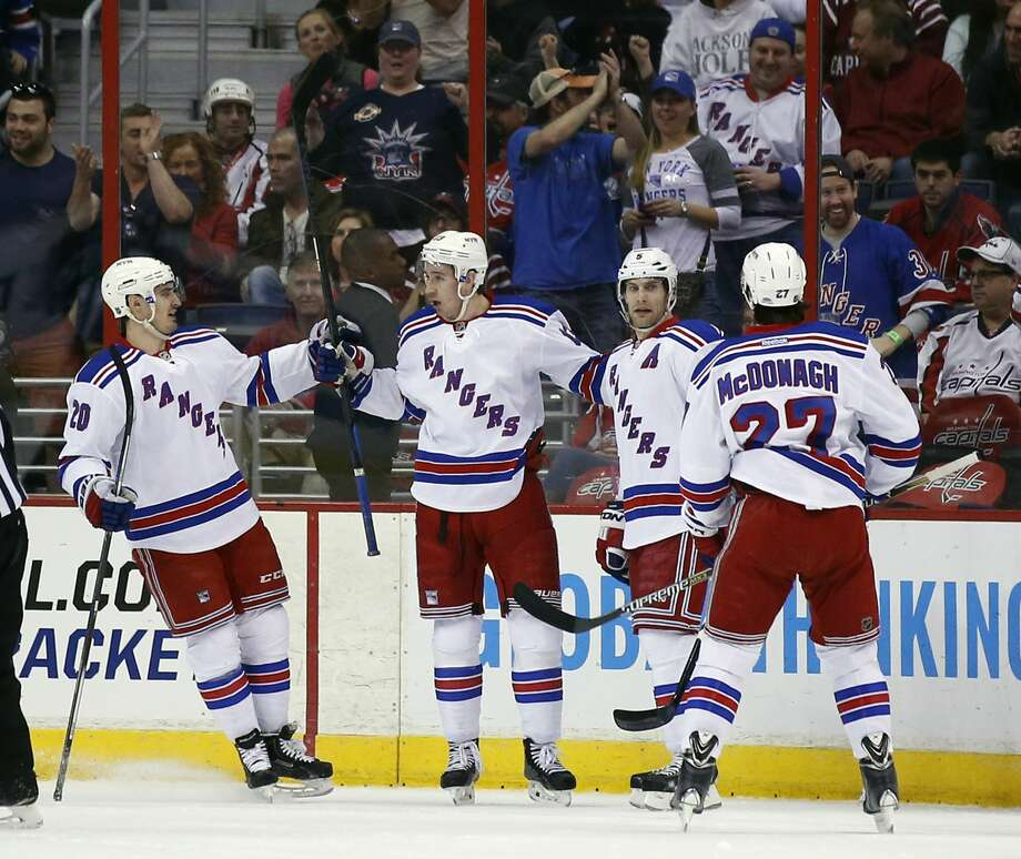 New York Rangers left wing Chris Kreider (20), right wing Kevin Hayes (13) and defensemen Dan Girardi (5) and Ryan McDonagh (27) celebrate Hayes' goal on Saturday in Washington. Photo: Alex Brandon — The Associated Press  / AP
