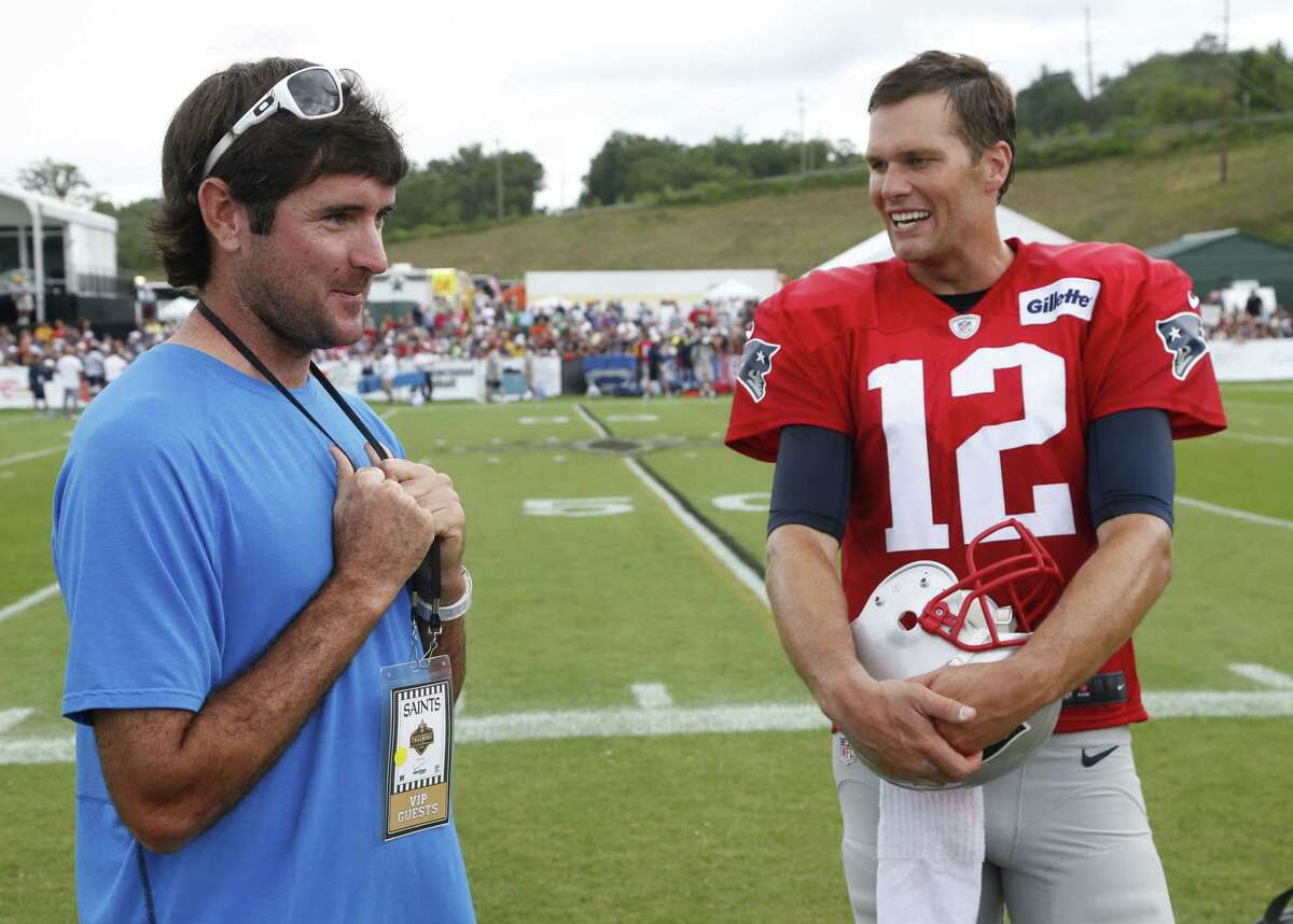 New England Patriots quarterback Tom Brady talks with pro golfer Bubba Watson Thursday after a joint practice between the Patriots and New Orleans Saints at the Saints' training camp in White Sulphur Springs, W.Va.