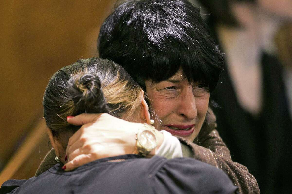 Terri Hernandez, mother of former New England Patriot Aaron Hernandez, hugs Shayanna Jenkins, Hernandez's fiancee, as the guilty verdict is read Wednesday at the Bristol County Superior Court in Fall River, Mass.