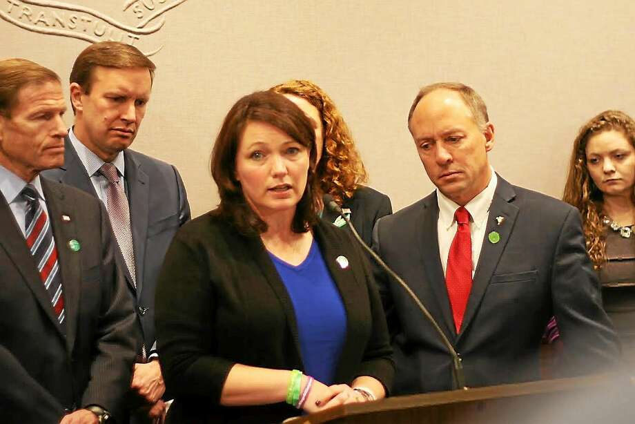 Nicole Hockley and Mark Barden, two Sandy Hook parents who lost their sons Dylan and Daniel on Dec. 14, 2012, speak at a press conference in Hartford on Dec. 15, 2014. Photo: Christine Stuart — Ctnewsjunkie.com