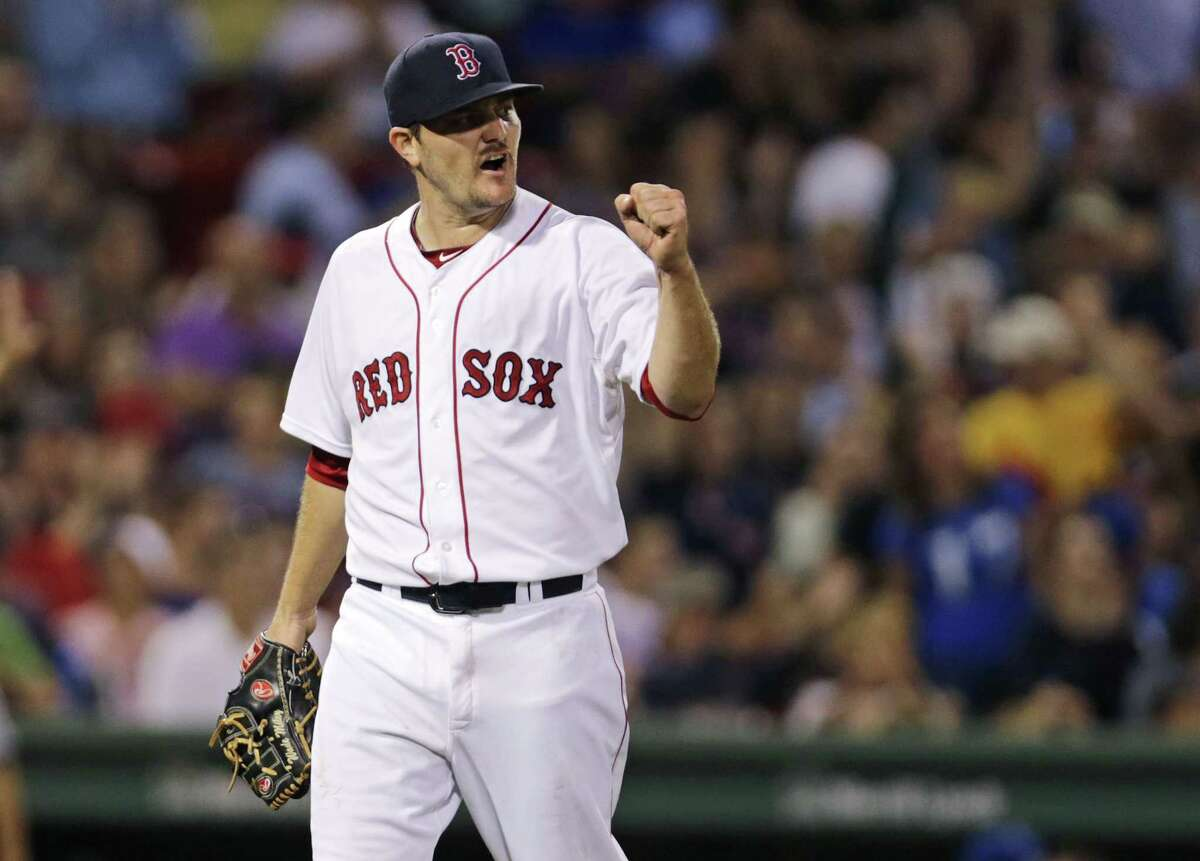 Red Sox starting pitcher Wade Miley pumps his fist after Mookie Betts snagged a line drive to end the top of the seventh inning on Thursday.