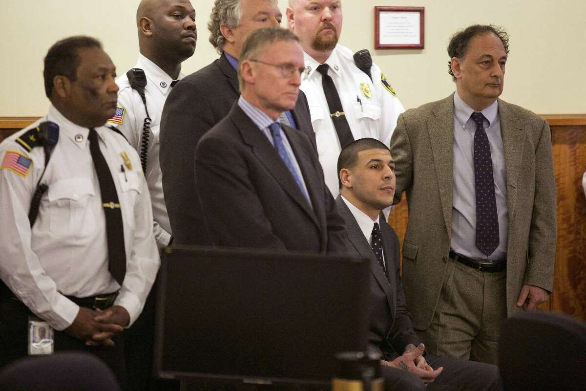 Former New England Patriot Aaron Hernandez and his defense team listen as the guilty verdict is read during his murder trial Wednesday at the Bristol County Superior Court in Fall River, Mass.