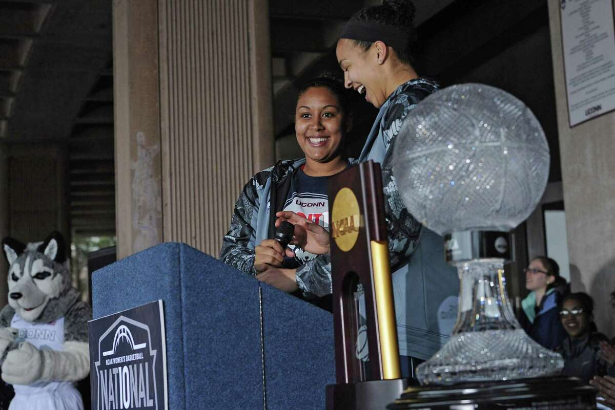 UConn seniors Kaleena Mosqueda-Lewis, left, and Kiah Stokes share a light moment during a rally on campus to celebrate the Huskies' 10th national title and third in a row on April 8 in Storrs.