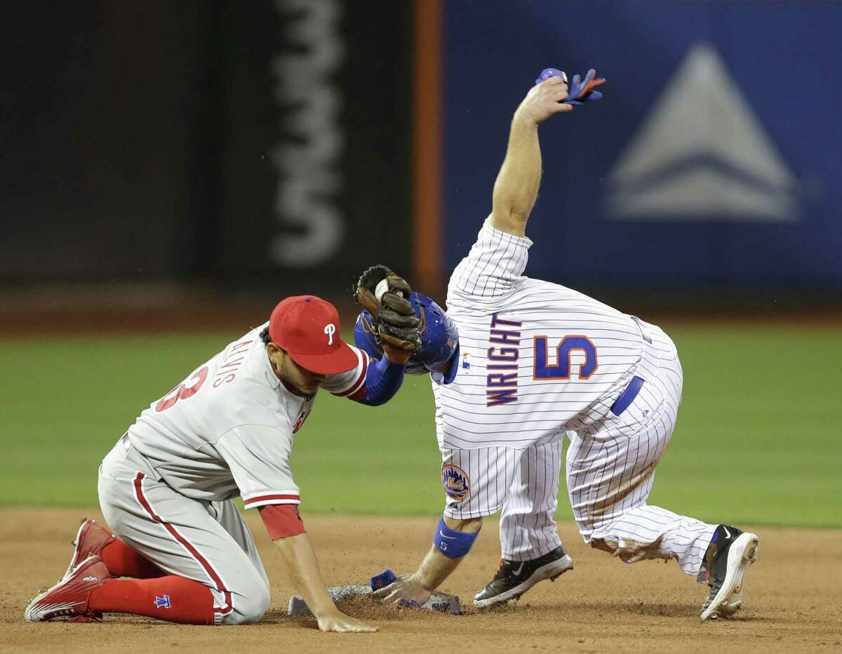 New York Mets third baseman David Wright injured his hamstring while stealing second base on Tuesday night in New York.
