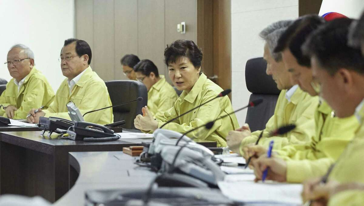 In this photo released by South Korean Presidential Bule House via Yonhap News Agency, South Korean President Park Geun-hye, center, speaks during the National Security Council (NSC) meeting at the presidential Blue House in Seoul, South Korea, Thursday, Aug. 20, 2015. South Korea's military fired dozens of shells Thursday at rival North Korea after the North lobbed a single artillery round at a South Korean border town, the South's Defense ministry said.