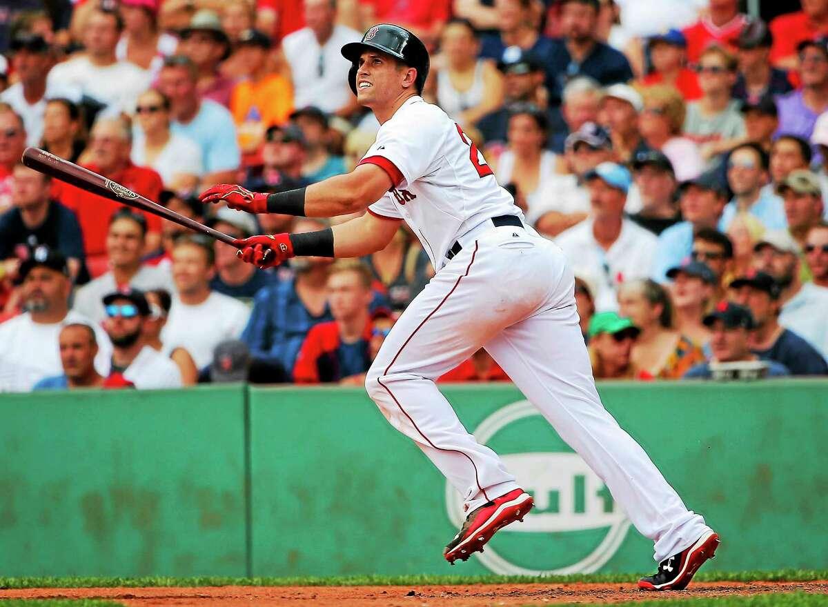 The Boston Red Sox traded Garin Cecchini to Milwaukee.