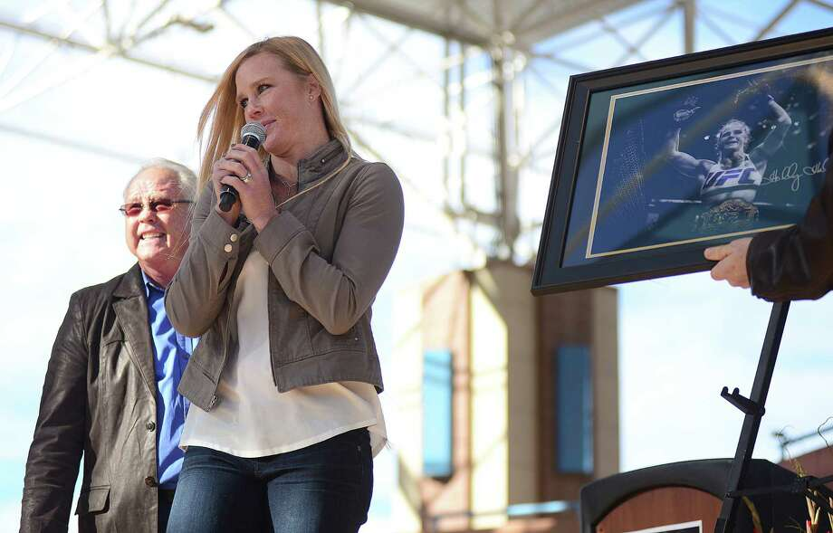 UFC bantamweight champion Holly Holm speaks to a packed Civic Plaza Sunday in Albuquerque, N.M., following a parade in her honor. Holm captured the belt from the previously undefeated Ronda Rousey on Nov. 14. Photo: Adolphe Pierre-Louis — The Albuquerque Journal  / The Albuquerque Journal