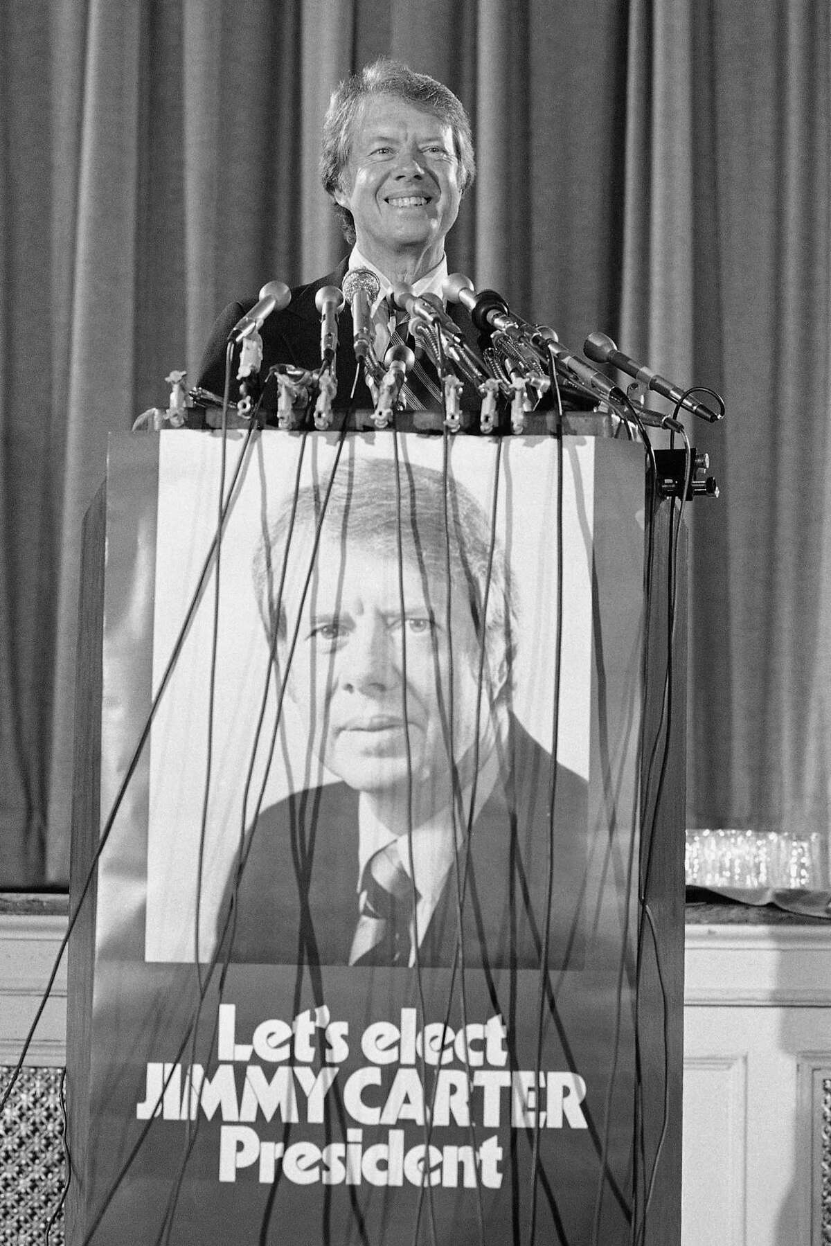 In this Aug. 14, 1975 photo, former Georgia Gov. Jimmy Carter announces in Washington that he qualified for federal matching funds to help finance his campaign for the 1976 Democratic presidential nomination.