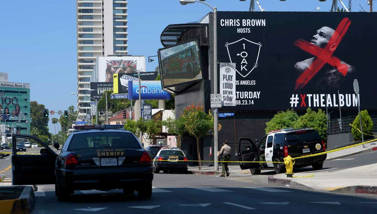 Police lines are set up outside the 1OAK club, Sunday, Aug. 24, 2014, in West Hollywood, Calif. Death Row Records founder and rap mogul Marion