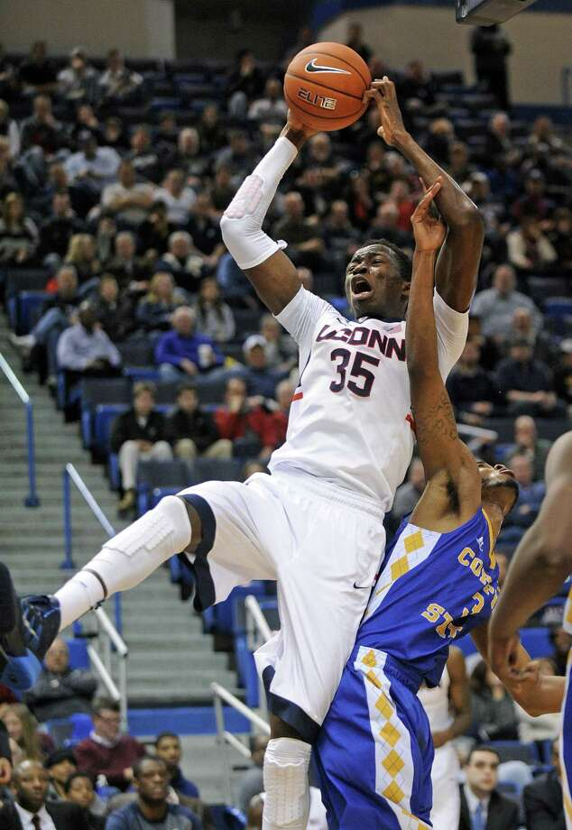 Connecticut's Amida Brimah (35) grabs a rebound over Coppin State's Arnold Fripp (3) during the second half of Connecticut's 106-85 victory in Hartford on Sunday. Brimah scored a career-high 40 points in the victory. Photo: FRED BECKHAM —The Associated Press  / FR153656 AP