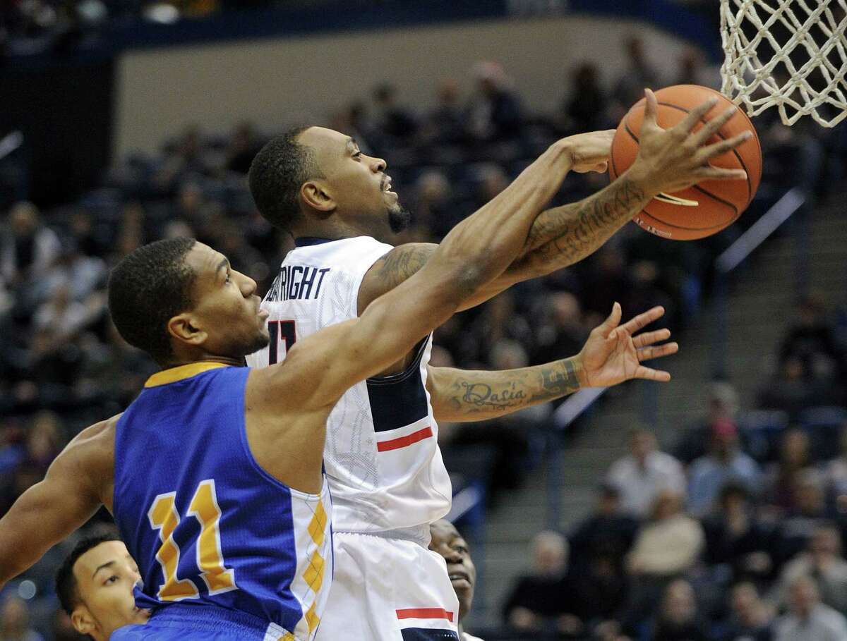 Connecticut's Ryan Boatright (11) drives past Coppin State's Taariq Cephas (11) during the first half .