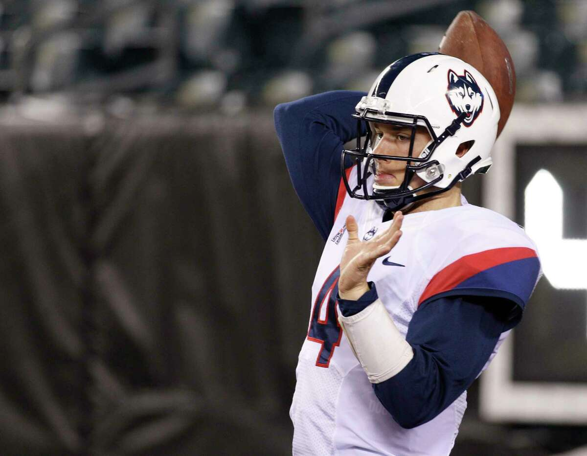 File Photo — The Associated Press Connecticut quarterback Bryant Shirreffs, seen warming up prior to UConn's game against Temple Nov. 28, is back practicing with the Huskies in preparation for the St. Petersburg Bowl Dec. 26.