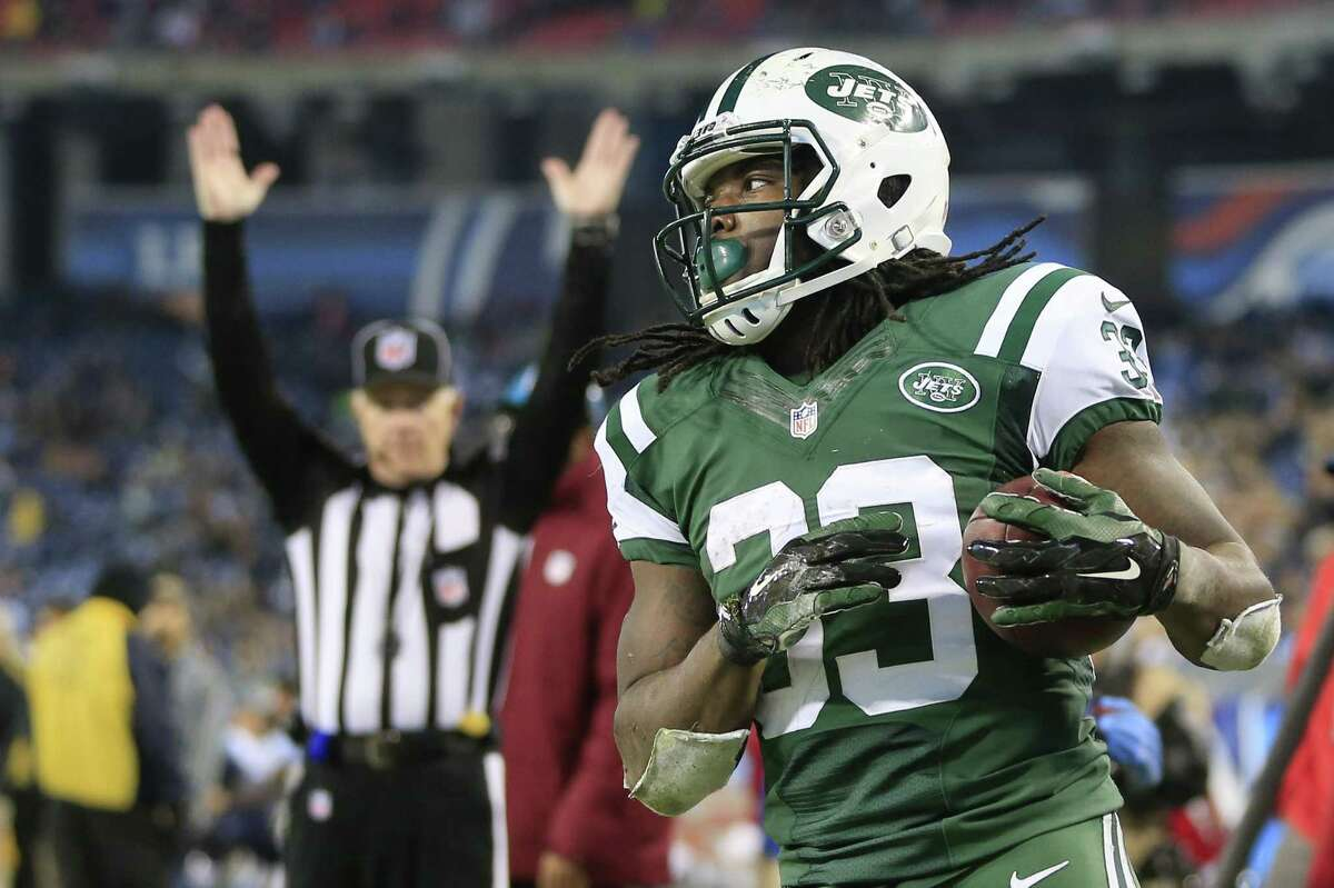 New York Jets running back Chris Ivory (33) scores the game-winning touchdown on a 1-yard run against the Tennessee Titans in the second half of an NFL football game Sunday, Dec. 14, 2014, in Nashville, Tenn. The Jets won 16-11.(AP Photo/James Kenney)